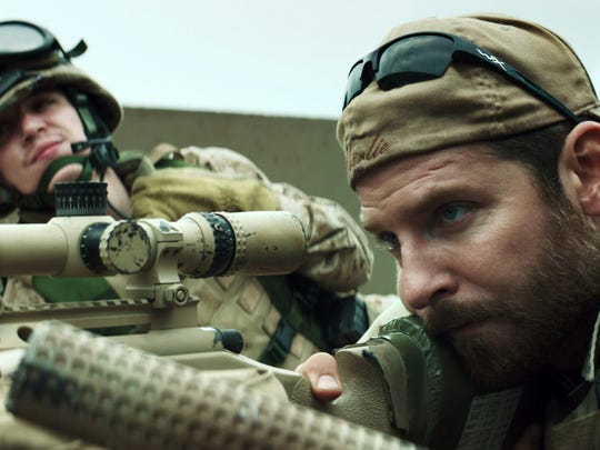 "In this image released by Warner Bros. Pictures, Kyle Gallner, left, and Bradley Cooper appear in a scene from the film, ""American Sniper,"" directed by Clint Eastwood."