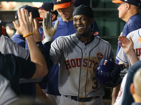 Cameron Maybin of the Houston Astros smiles in the dugout after scoring on a single by George Springer in the fourth inning of a baseball game against the Texas Rangers at Globe Life Park in Arlington Sept. 26, 2017, in Arlington, Texas.