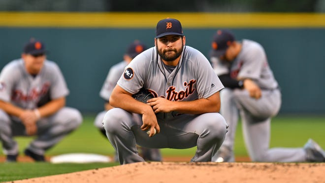 Tigers pitcher Michael Fulmer (32) looks on during a delay of play in the first inning on Tuesday, Aug. 29, 2017, in Denver.