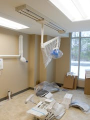 One of eight dental exam rooms nears completion at
