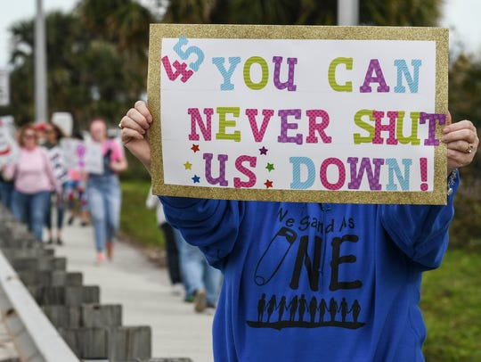 Thousands rally along the Eau Gallie Causeway during the 2018 Brevard Women's March.