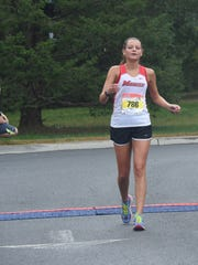Annie Gould of Stormville crosses the finish line to