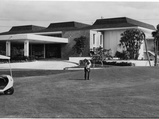 A golfer in front of Cape Coral Country Club in the 1960s.