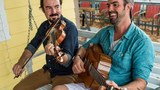 Brothers Joel and Wilson Savoy play music on Wilson's porch in Lafayette, La., December 10, 2015.