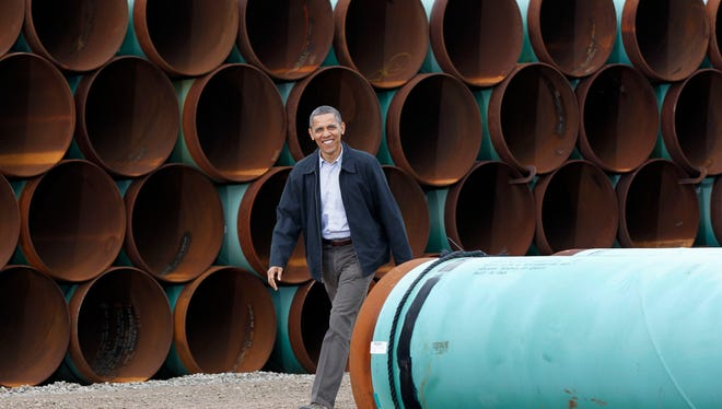 This March 22, 2012 file photo shows President Barack Obama arriving at the TransCanada Stillwater Pipe Yard in Cushing, Okla. Debate continues over the proposed Keystone XL oil pipeline from Canada to Texas. The 1,700-mile pipeline would carry oil from tar sands in Alberta to refineries in the Houston area.