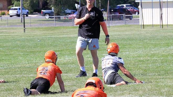 Sturgis head football coach Chance Stewart leads his team through training drills, before football was halted. HSAA is allowing some sports to move forward, but football is not among them.