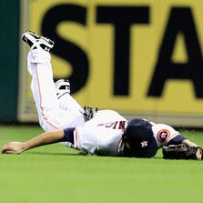 HOUSTON, TX - AUGUST 25:  Jake Marisnick #6 of the Houston Astros makes a diving attempt on a soft line drive in the fifth inning against the Oakland Athletics at Minute Maid Park on August 25, 2014 in Houston, Texas.  (Photo by Bob Levey/Getty Images)