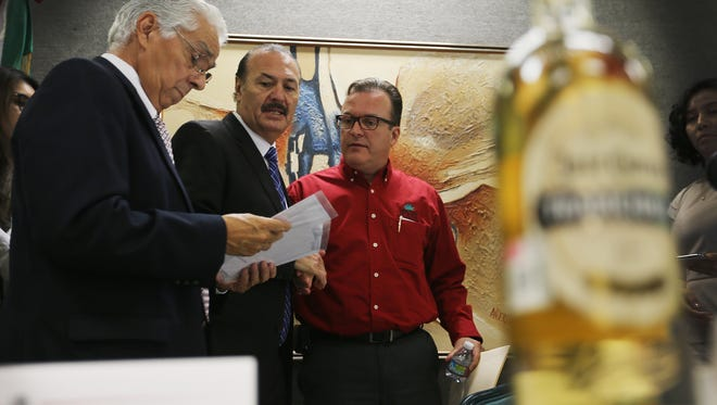 Consul General Marcos Bucio, center, talked with Mexican Chamber of Commerce in Ciudad Juarez President Alejandro Ramirez, right and chamber Vice President for Binational Relations Jose Contreras at the conclusion of a press conference to announce the annual Festival del Tequila y del Mariachi Sept. 2, 3 and 4 in Ciudad Juarez.