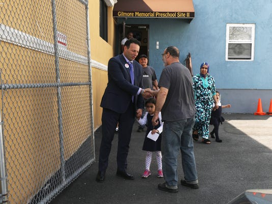 The newly elected Mayor of Paterson Andre Sayegh picks his daughter up at pre school this afternoon and is congratulated by other parents on his victory in the Paterson mayoral race.