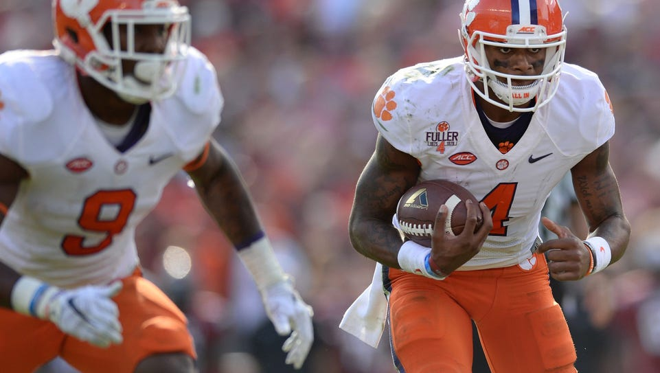 Clemson quarterback Deshaun Watson (4) looks for running
