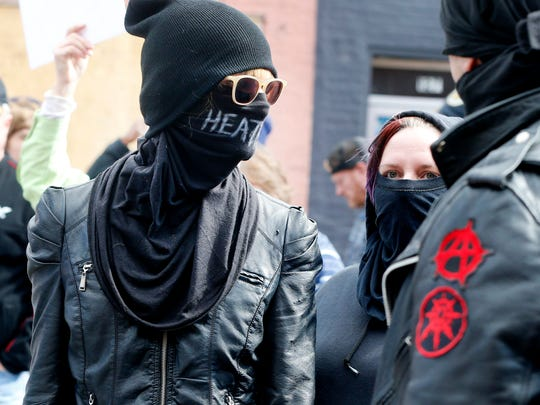 Members of Antifa wait to enter the White Lives Matter rally on the square in Murfreesboro, on Saturday, Oct. 28, 2017.
