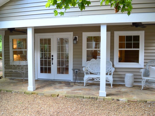 The guest house front porch overlooks the backyard.jpg
