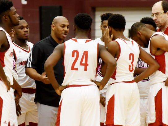North Caddo coach Michael Wilson talks with his team
