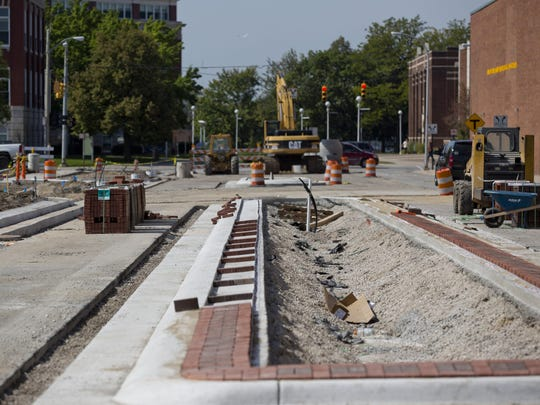 Work is being done on a median Friday along McMorran Boulevard near the Blue Water Area Transit bus hub in downtown Port Huron.