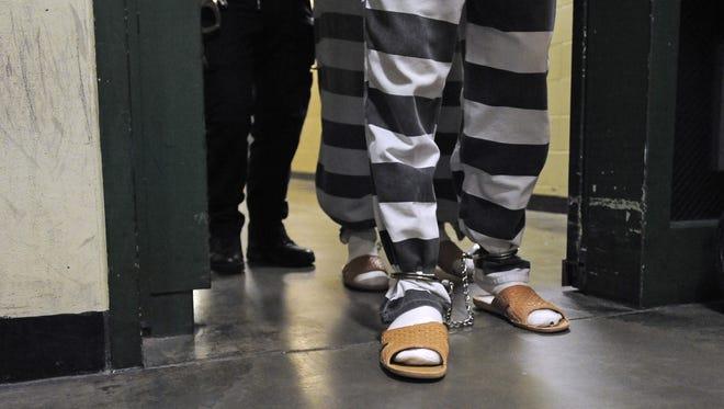 Inmates enter the Minnehaha County Jail.