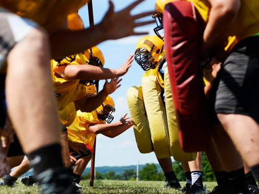 The Eastern York football team runs drills during the