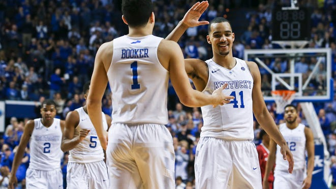 Kentucky's Devin Booker and Trey Lyles congratulate each other late in the second half during the Wildcats' 84-67 win Saturday over Arkansas. Booker had 10 points and Lyles 18.