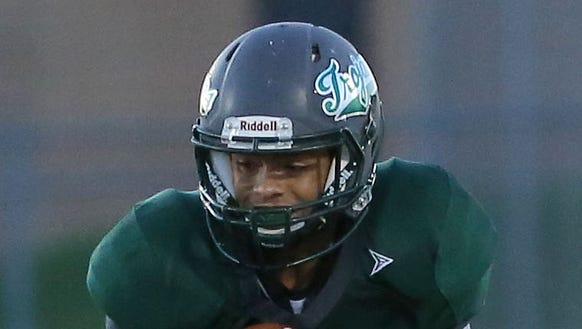 Wauwatosa West quarterback Jamil Razza ran for two