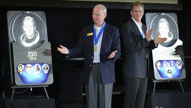 In May 2016, U.S. Astronaut Hall of Fame inductees Brian Duffy and Scott Parazynski stood next to their newly unveiled plaques at the Kennedy Space Center Visitor Complex.