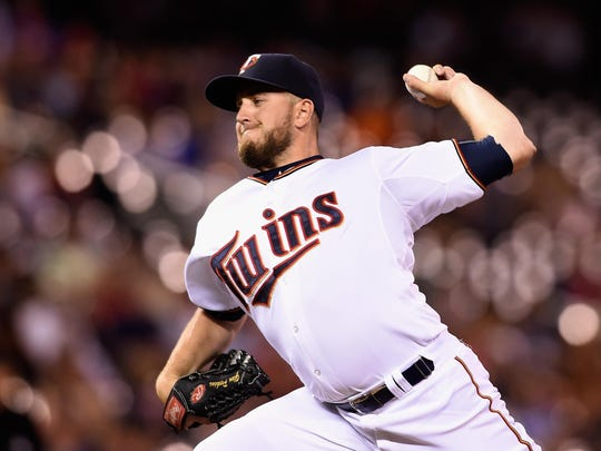Glen Perkins of the Minnesota Twins delivers a pitch against the Texas Rangers during the ninth inning of the game on August 11, 2015 at Target Field in Minneapolis. Perkins helped create the Four Seam Screamer, a new beer by Surley Brewing Company, for the 2019 Minnesota State Fair.