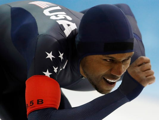 """FILE - In this Jan. 6, 2018 file photo, Shani Davis competes in the men's 1,500 meters during the U.S. Olympic long track speed skating trials, in Milwaukee. A tweet posted to the account of Davis is blasting the selection of luge athlete Erin Hamlin as the U.S. flagbearer for the opening ceremony at the Pyeongchang Games. The tweet says the selection was made """"dishonorably,"""" and included a reference to Black History Month in a hashtag. Hamlin and Davis each got four votes in the final balloting of the athlete-led process.  (AP Photo/John Locher, File)"""