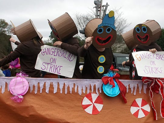 A Gingerbread on Strike float was one of the quirky entries Sunday in the Denver Downs Christmas Parade.