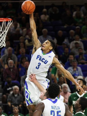 FGCU's Julian Debose scores against Jacksonville on Saturday at Alico Arena in Fort Myers.