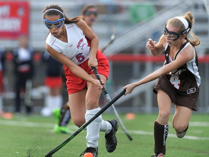 Fairport's Melia Gasbarre, left, and East Rochester's Hannah Heffernan challenge for the ball.