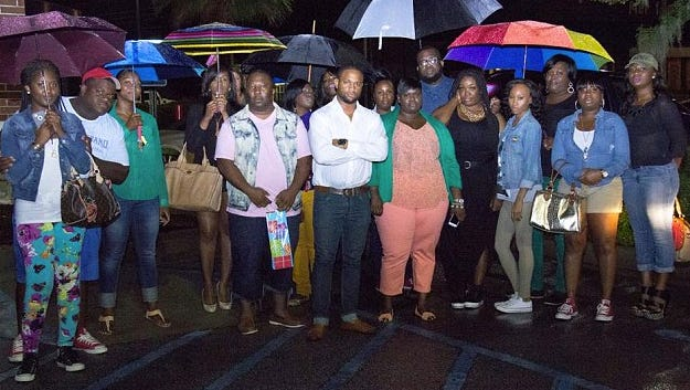 Michael Brown, also known as Mike London, center, and the family and friends who he says were denied seating at a North Charleston, S.C., restaurant.