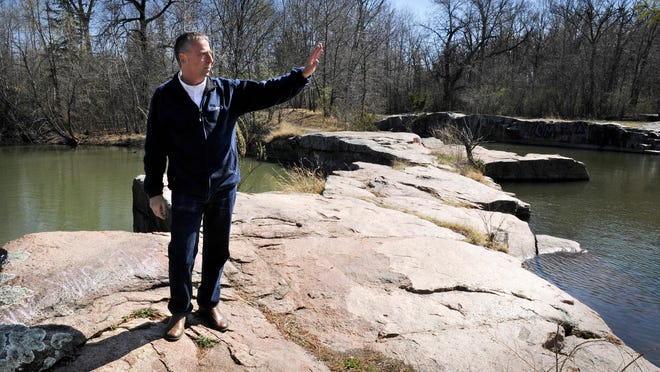 St. Cloud Mayor Dave Kleis talks about plans Wednesday for the 50-acre Friedrich Park in St. Cloud. The park contains several quarries and granite outcroppings.