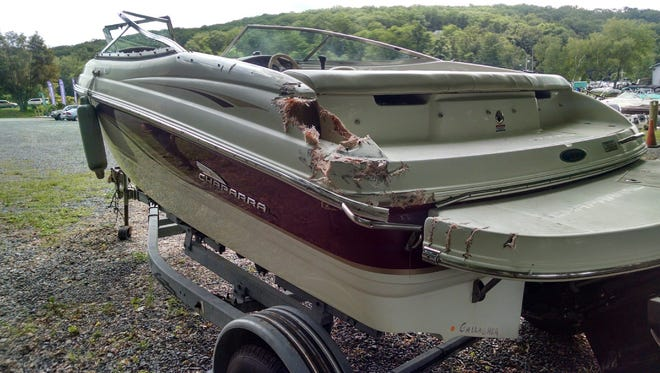 The New Jersey State Police are trying to find a boater who allegedly crashed his boat into this one Saturday on Lake Hopatcong, causing extensive damage and injuring two of the five people aboard it.