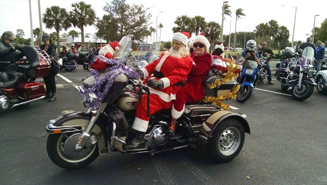 Santa and Mrs. Claus, also known as Robert and Audrey Cran of North Fort Myers, get ready to lead the pack to distribute presents to veterans in Charlotte County on Sunday.