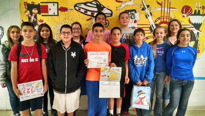This year I had 130 posters submitted from Ruidoso, Hondo, Mescalero and Santa Teresa middle school. I had one winner from Hondo and two winners from Ruidoso. I have attached their photos. Each winner received a $25 gift card for Barns and Noble. The project teaches students to make responsible choices.   Middle school students from Hondo entered their art work in an anti-gambling poster contest. Erwin Rodriguez won for hondo and received a gift card.