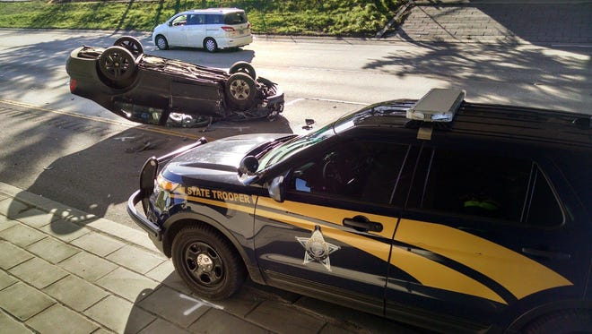 A Volkswagen Jetta hit a parked Oregon State Trooper vehicle on Tuesday afternoon. Neither the OSP trooper or the Jetta driver were seriously injured.