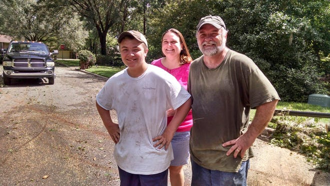Thanks to the Ison family pictured here,  a huge tree that fell across Fogarty Drive was cut up and removed from the street after Hurricane Hermine in Tallahassee, FL.  According to Fogarty Drive resident Bill Edwards, the Wakulla County evacuee family  drove around the area with a chainsaw helping others free of charge.  All they asked is to pay it forward.  Photo courtesy of Bill Edwards.