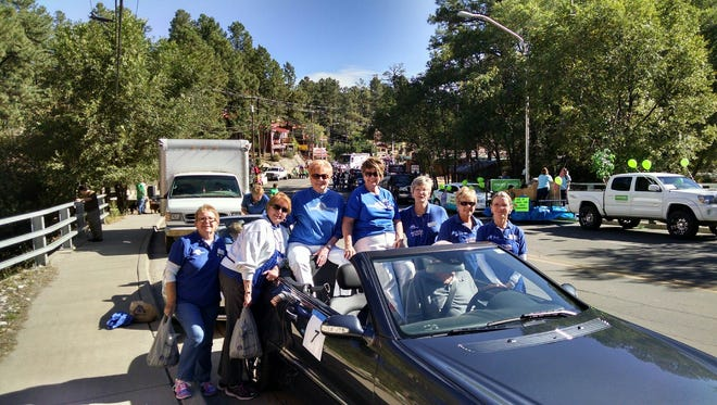 Members of Ruidoso Altrusa handed out flyers for their October low-cost mammogram program during the Aspenfest parade.