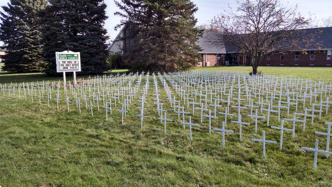 Crosses placed on the lawn of Faith Bible Church in Delta Township as part of an anti-abortion display. The crosses were apparently vandalized on Tuesday, Nov. 14, 2017.