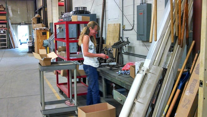 Tammy Wellman works at the Clyde plant of Progress TAC, which designs and builds custom automation for United Industries and has equipment in 20 countries