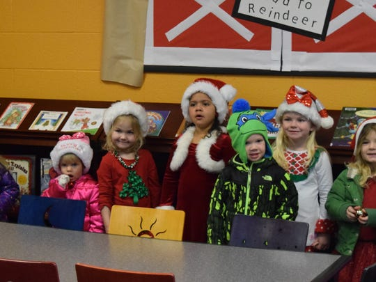 The toddlers line up for a photo op before the caroling began.