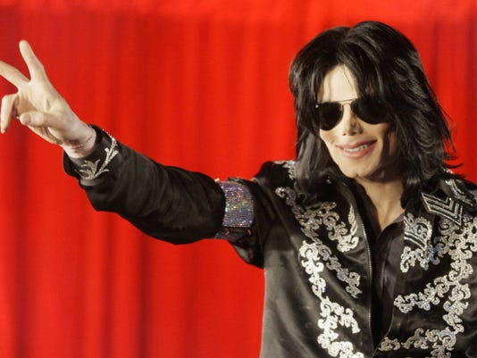 FILE - In this March 5, 2009 file photo, US singer Michael Jackson speaks at a press conference at the London O2 Arena.