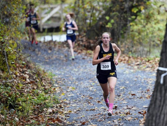 Delone Catholic's Kate Mowrey leads the pack during the District 3 Class A girls' cross country championships in October. Mowrey finished second, and the Squirettes won the district team title.