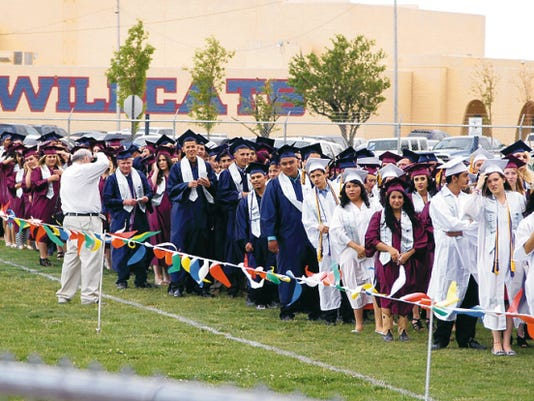 Headlight File Photo   Last year's Deming High School graduating class lined up to enter DHS Memorial Stadium. The Class of 2015 is set to walk during commencement exercise at 7:30 p.m., on Friday.