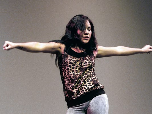 Asia Soleil Yazzie performs a dance routine during the inaugural Survival of the First Voices Festival in July 2014 at the Henderson Fine Arts Center at San Juan College in Farmington.