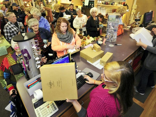 Shoppers pay for items at Route 5 Fine Gifts Wednesday, Oct. 28. The store held a liquidation sale of all merchandise through Oct. 31.  After seeing customers' enthusiasm for the shop and its items, Tanya Nitterhouse, who bought the property and the inventory from the former owners, said she has high hopes that the business can be revived again one day.