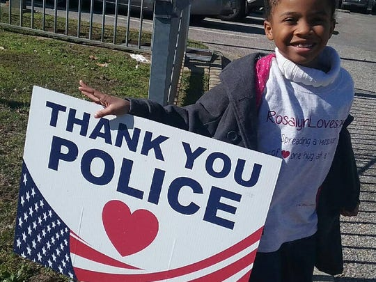 Rosalyn Baldwin, a 7-year-old from Hammond, is traveling the country with her family to hug a police officer in every state.