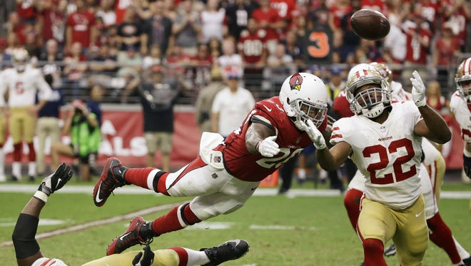 Arizona Cardinals Deone Bucannon (20) breaks-up the pass to San Francisco 49ers running back Matt Breida in the second half on Oct. 1, 2017 at University of Phoenix Stadium in Glendale, Ariz.