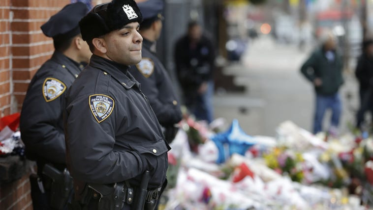 New York City police officers watch over a makeshift