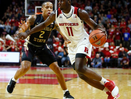 Rutgers Eugene Omoruyi drives to the hoop on his way