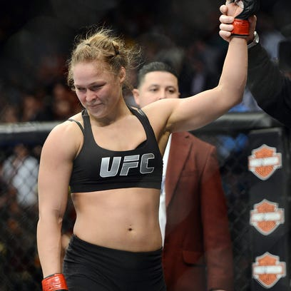 Dec 28, 2013; Las Vegas, NV, USA;    Ronda Rousey reacts after defeating Miesha Tate (not pictured) in their UFC women's bantamweight championship bout at the MGM Grand Garden Arena. Mandatory Credit: Jayne Kamin-Oncea-USA TODAY Sports ORG XMIT: USATSI-154044 ORIG FILE ID:  20131228_jla_aj4_589.jpg