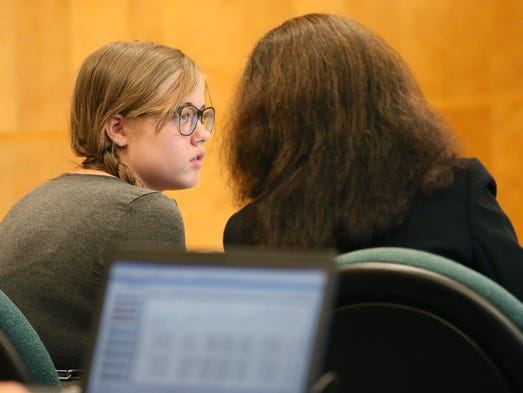 Morgan Geyser looks toward one of her lawyers during